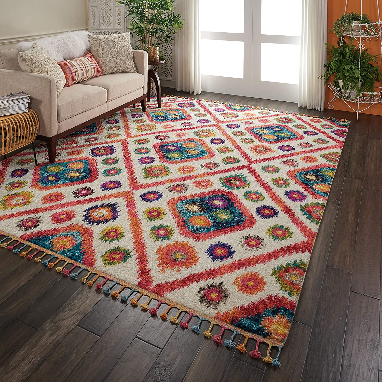 Colorful patterned rug with tassels.
