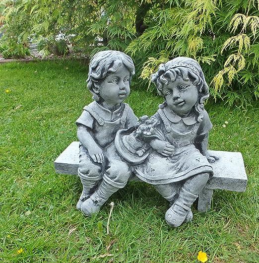 Niña y niño en banco Niños piedra Figura Escultura Jardín Figura de piedra color: gris: Amazon.es: Jardín
