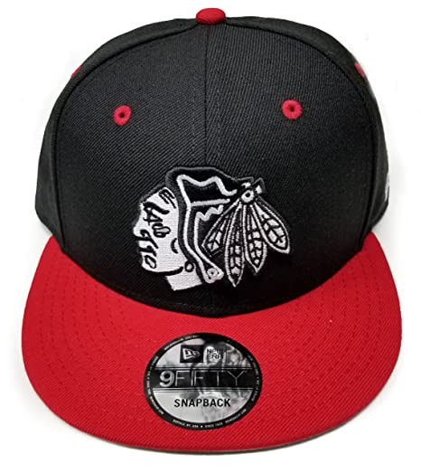 a65dac540cb Amazon.com   New Era Chicago Blackhawks Solid Wool Black   White ...