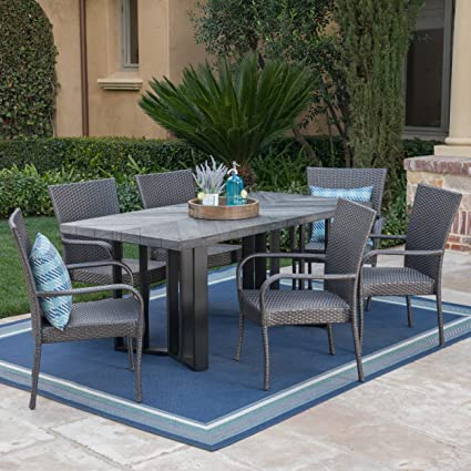 Amazon Com Christopher Knight Home Fiona Outdoor 7 Piece Grey Wicker Dining Set With Textured Grey Oak Finish Light Weight Concrete Dining Table Garden Outdoor