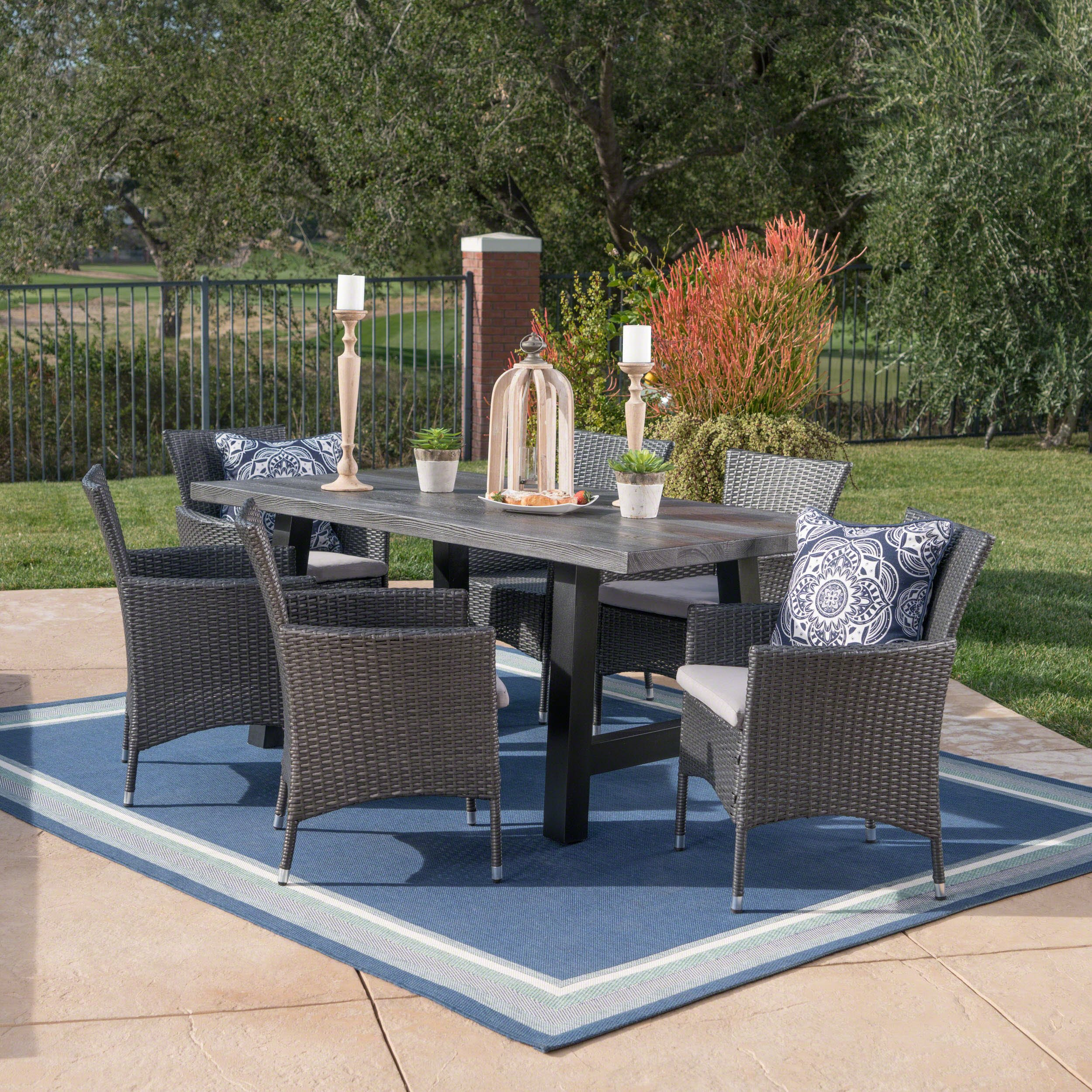 Gina Outdoor 7 Piece Grey Wicker Dining Set with Natural Grey Finish Light Weight Concrete Table and Silver Water Resistant Cushions by Great Deal Furniture