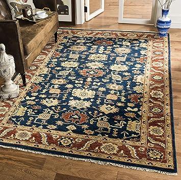 Amazon Com Safavieh Heriz Collection Hrz277b Hand Knotted Traditional Premium Wool Area Rug 9 X 12 Navy Rust Furniture Decor