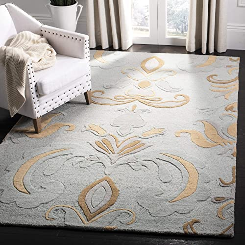 Safavieh Soho Collection SOH215A Handmade Light Blue and Multi Premium Wool Area Rug 7'6″ x 9'6″