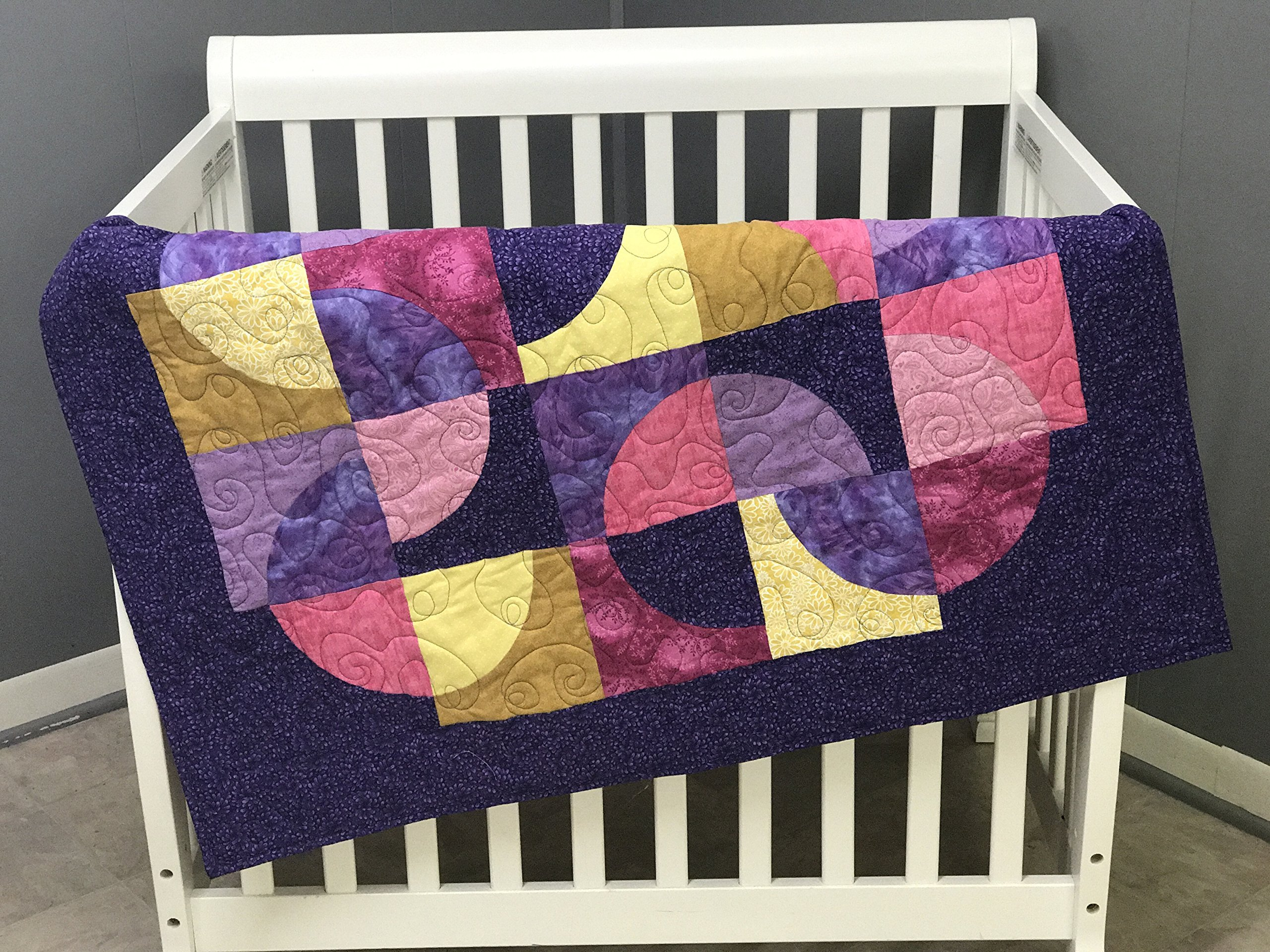 Baby Girl Quilt in bright pinks, yellows and purples. Handmade, One of a kind. Custom colors available. Made with 100% cotton fabric. 36'' x 43.''