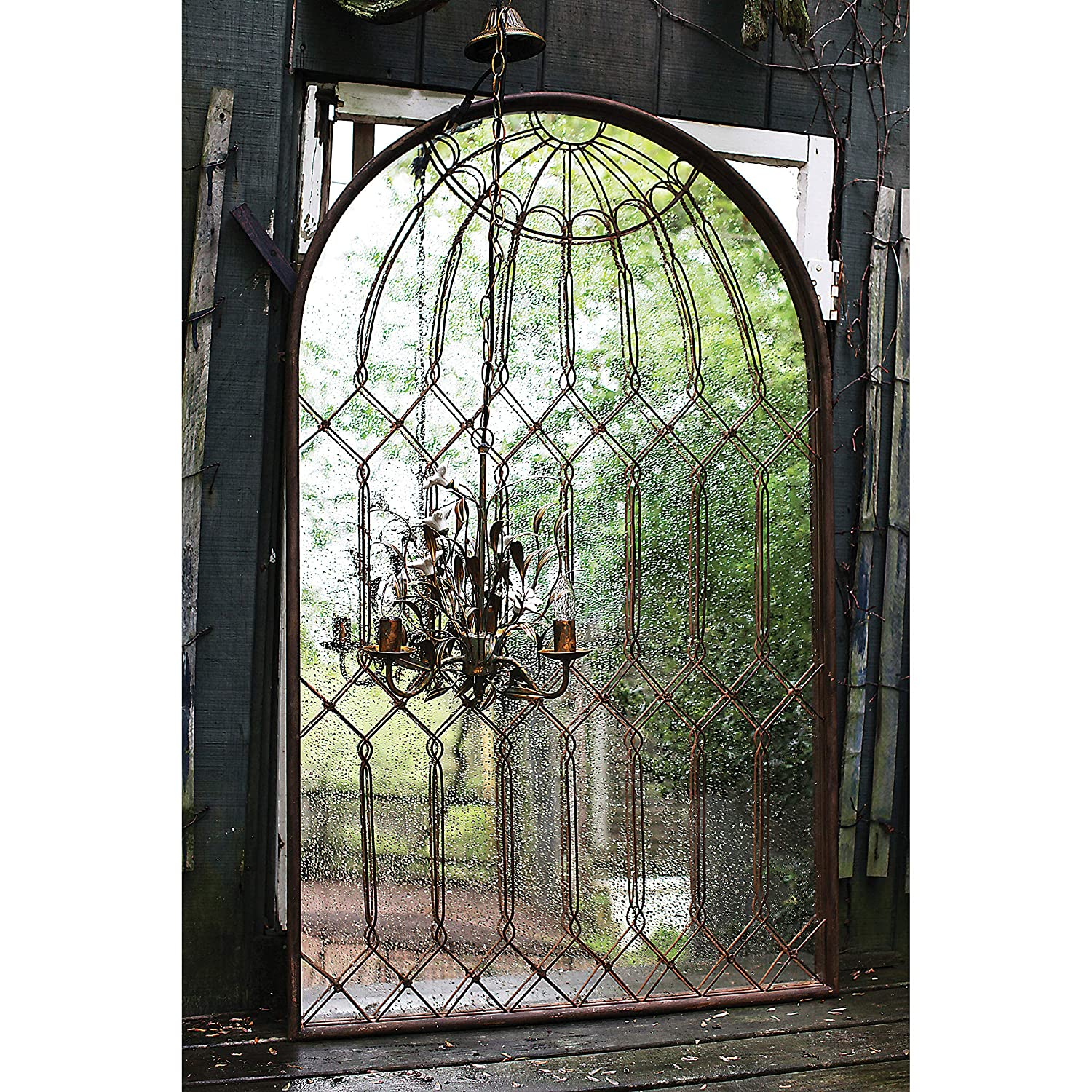 French farmhouse style iron arch top mirror with birdcage like style.