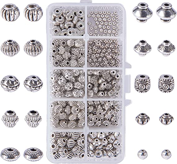 10 perles TIBETAINES argentées RONDES 8X7mm ////4