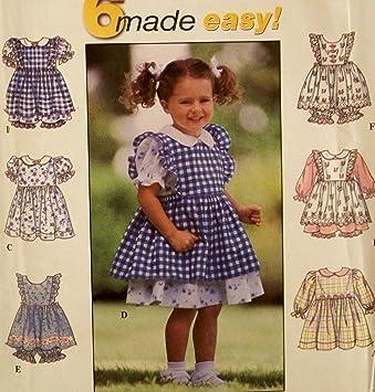 1e9285a66 Patrón Simplicity 8540. Tallas para niñas/niños/bebés 1/2; 1; 2 vestidos,  pinafore y braguitas. Casual para vestir. Pascua, etc.: Amazon.es: Juguetes  y ...