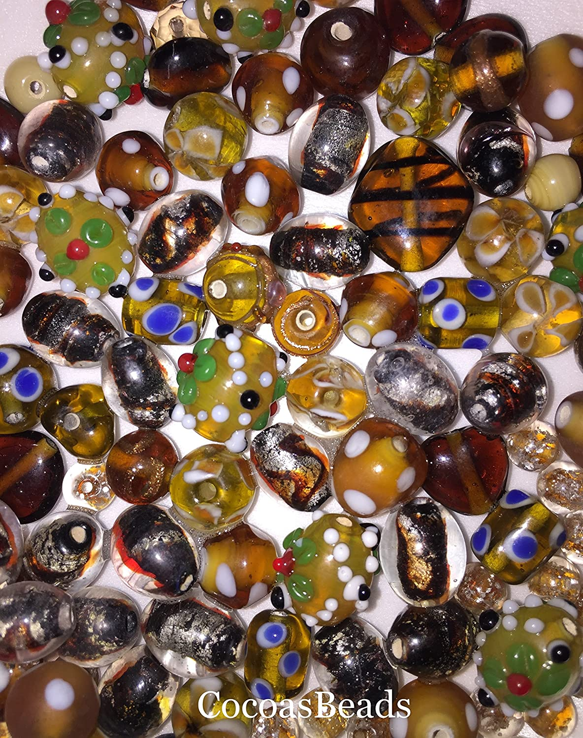 75 grams of Amber Czech Glass Beads in assorted Shapes