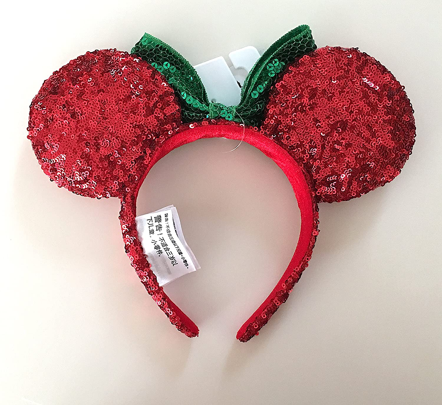 7ef1ec0ef53 Amazon.com  Disney Parks Minnie Mouse Bow Green Red Sequin Ears Headband   Clothing
