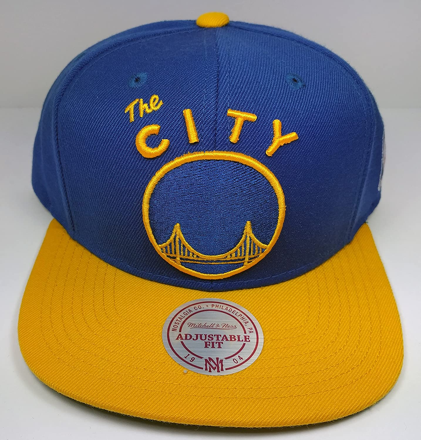 best service 7f748 95f93 Amazon.com   Mitchell   Ness Golden State Warriors Vintage 2 Tone Solid  Wool The City Snapback Hat NBA   Sports   Outdoors