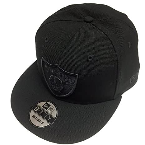 2e0471bc2 Amazon.com   New Era NFL Oakland Raiders All Black Shield Logo Snapback Cap  9Fifty NewEra   Sports   Outdoors