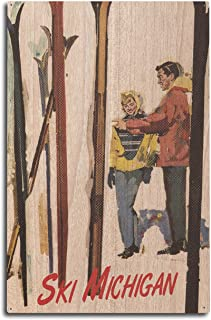 product image for Lantern Press Ski Michigan - Couple by Skis in The Snow (10x15 Wood Wall Sign, Wall Decor Ready to Hang)