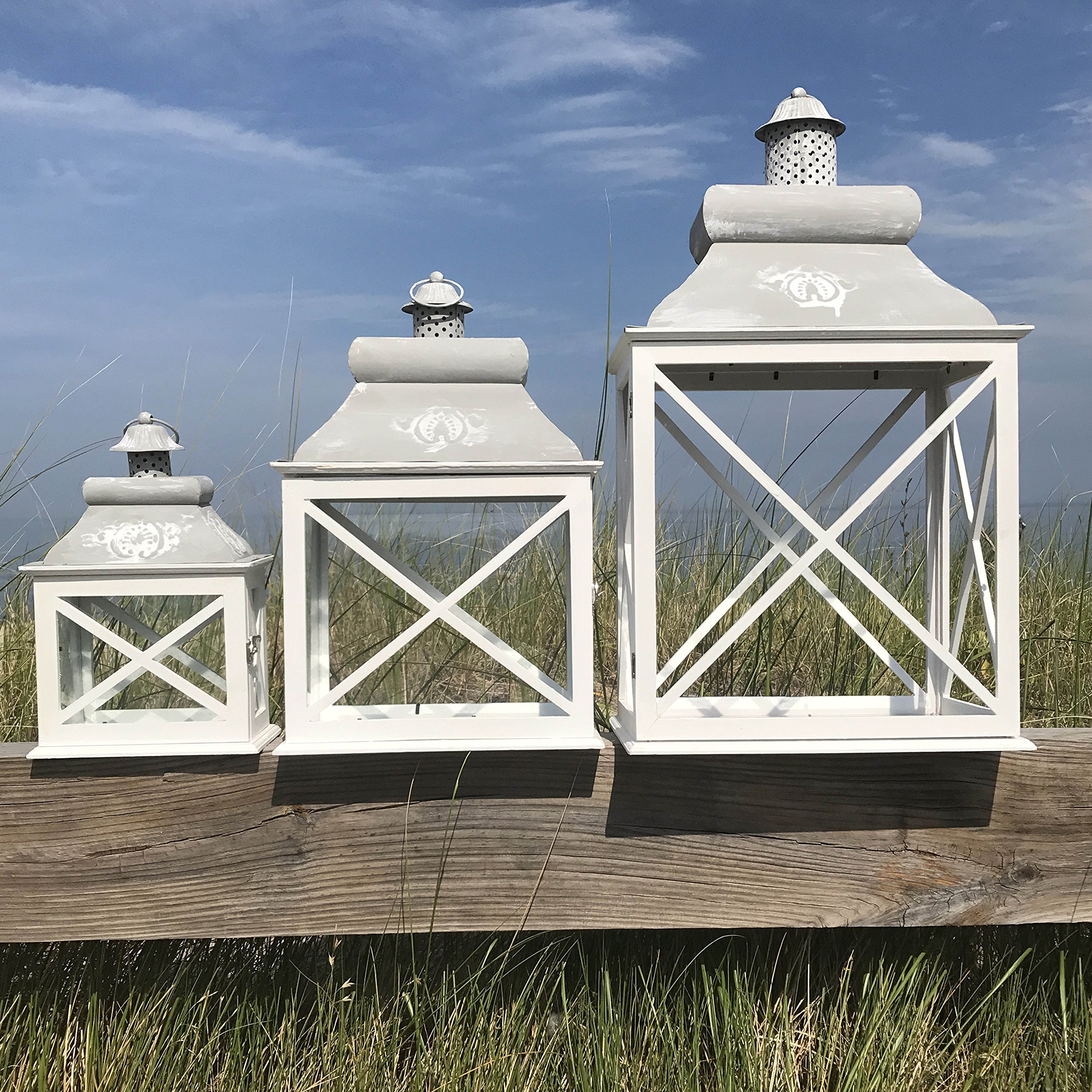 The French Country Style Set of 3 Rustic Lanterns, Chateaux Style Roof, Raised Medallion, Gray Distressed Surface, Galvanized Metal Reflective Bottom, Glass, Wooden Cross Post Panels, Various Sizes by Whole House Worlds