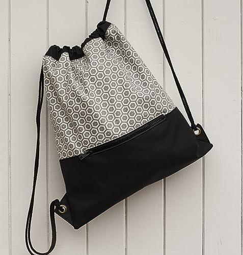 Mochila de cuerdas combinada en tejido de algodón y vinilo con bolsillo cremallera exterior
