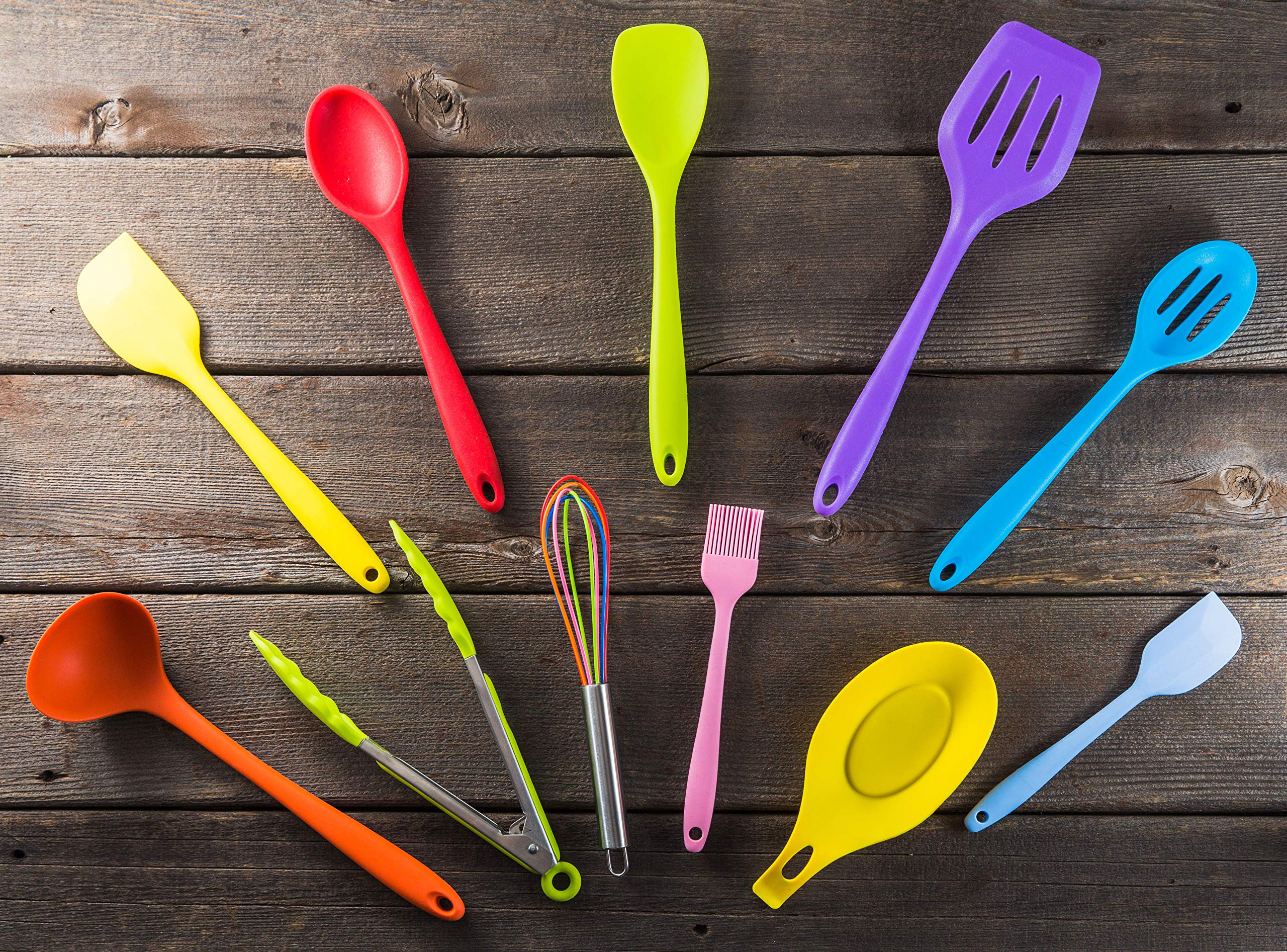 11pc Silicone Kitchen Utensil Set by CuisineFacets Colorful Cooking Utensils with Spatula, Serving Tools, Accessories and FREE Spoon Rest - Heat Resistant Spatulas and Spoons for Non-Stick Cookware 3 ✅11PC incl. FREE SPOON REST: Imagine how many colorful food creations you can now unleash all at once, because your utensil set includes everything! Silicone Wisk, Pastry Brush, 2x Spatulas, Slotted Spoon, Salad Spoon, Food Tong, All-Purpose Spoon, large Ladle, Slotted Turner, and BONUS Spoon Rest. ✅HEAT RESISTANT & EASY TO CLEAN: From the Rainbow Whisk to the Pink Pastry Brush, just pop your silicone kitchen utensils in the dishwasher to clean. Everything is made from FDA Compliant Food Grade Silicone and can withstand temperatures up to 446°F... like steaming hot pasta, pumpkin soup or pancakes. ✅WHAT'S YOUR FAVE? If you're like most people, there are always 1 or 2 kitchen tools you love the most. And if you're like us, it could even be because of color. Either way, our Cheery Utensils Set from CuisineFacets gives you the best of both - your favorite non-stick kitchen utensils, in your favorite colors too.