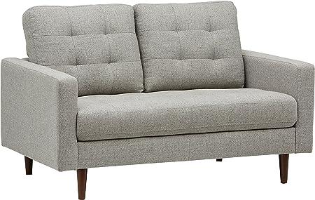 Impresiona a tus amigos con un estilo Mid-century Modern. El contorno cuadrado de este sofá de dos p
