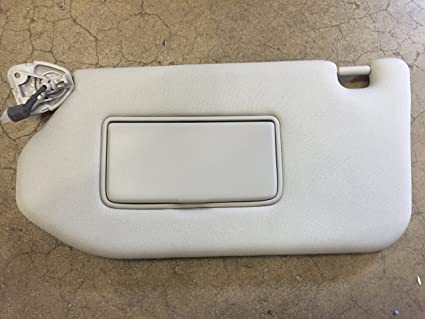 Image Unavailable. Image not available for. Color  NEW OEM NISSAN DRIVERS  SIDE SUNVISOR ... 2b41e715749