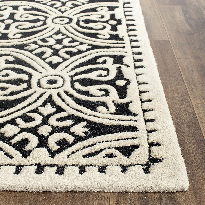 Safavieh Marina handgetufteter Teppich, CAM123A, Hellblau     Elfenbein, 91 X 152  cm B00CM8XZU0 Teppiche 8b76bc