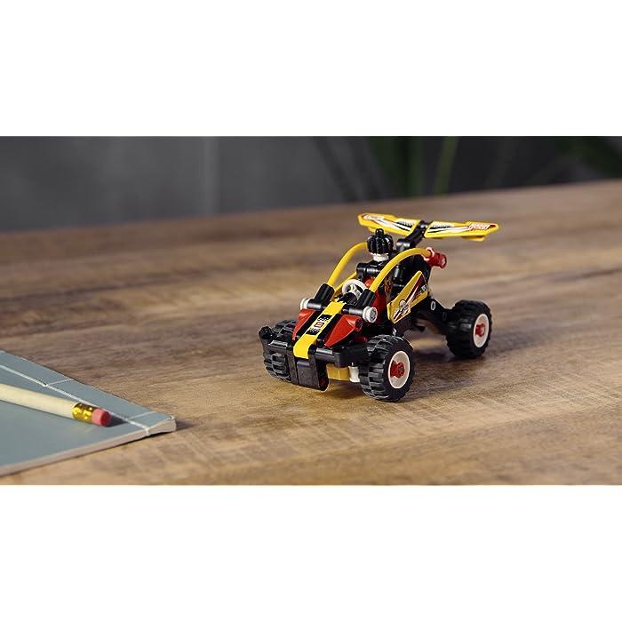 """B1nKR1RPldS ¡Un divertido desafío de construcción para niños que adoran los juguetes de carreras! Construye el Buggy y recrea una aventura de conducción por zonas escarpadas e irregulares. Conviértelo después en un coche de carreras para seguir divirtiéndote mientras lo transformas e interpretas competiciones de velocidad. Equipado con sistema de suspensión y mecanismo de dirección, este set de juguetes de acción (42101) propone un interesante desafío de construcción. Contribuye a desarrollar las habilidades de resolución de problemas y ofrece también un montón de oportunidades de practicar el juego imaginativo. El diseño """"2 en 1"""" duplica la diversión. Los niños pueden construir el Buggy y luego convertir la maqueta en un ágil coche de carreras. Cuando el modelo esté terminado, a los peques les encantará jugar con su creación o ponerla a interactuar con otros vehículos de juguete construibles."""