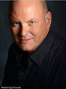 Mark L. Tompkins