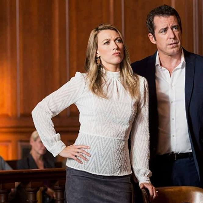 Jason Jones and Natalie Zea in The Detour (2016)