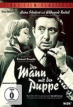 Der Mann mit der Puppe