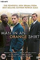 Image of Man in an Orange Shirt