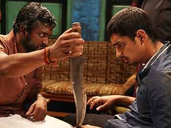 Siddharth and Bobby Simha in Jigarthanda (2014)