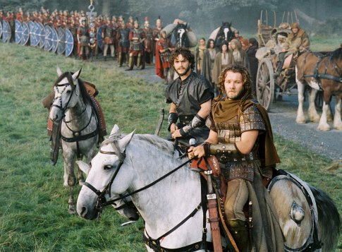 Arthur's Knights of the Round Table, including Galahad (Hugh Dancy, center) and Gawain (Joel Edgerton, right) stand ready to protect the traveling caravan.