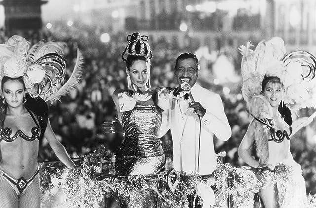 Sonia Braga and Sammy Davis Jr. in Moon Over Parador (1988)