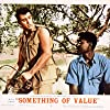 Rock Hudson and Sidney Poitier in Something of Value (1957)