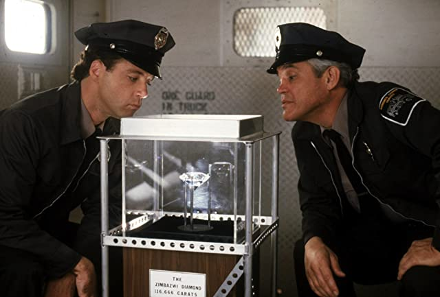 G.W. Bailey and Lance Kinsey in Police Academy 6: City Under Siege (1989)