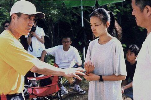 Yimou Zhang, Benshan Zhao, and Jie Dong in Happy Times (2000)