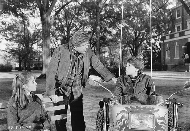 Corey Haim, Gary Busey, and Megan Follows in Silver Bullet (1985)