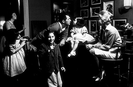 Dean Martin with his wife, Jeanne Beiggers, daughter, Gina, and son, Dino, at home in Brentwood, CA, 1961.