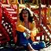 George Harrison posing with colorful wooden lounge chairs, January 1977