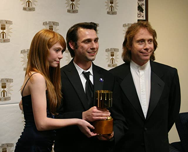 Presenters Liliana Mumy (l) and Bill Mumy (r) with Michal Makarewicz, winner for feature character animation