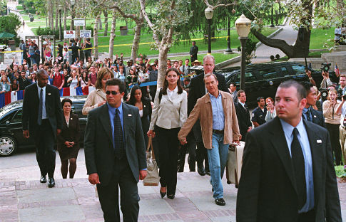 On her first day at college, First Daughter Samantha Mackenzie (Katie Holmes, center, left) is accompanied by her dad - the President of the United States (Michael Keaton) - and a team of Secret Service agents.