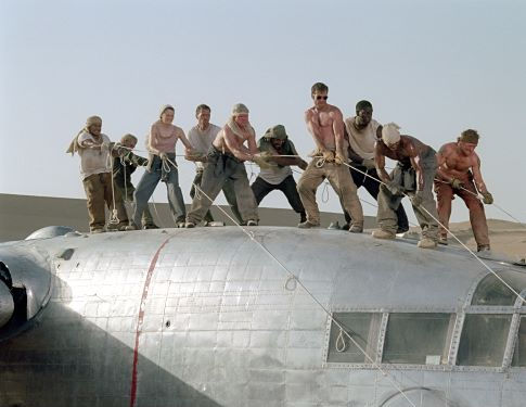 The survivors of a downed aircraft pull together to build a new plane out of the wreckage of the old one. (L to R) Jacob Vargas, Giovanni Ribisi, Miranda Otto, Hugh Laurie, Scott Michael Campbell, Kevork Malikyan, Dennis Quaid, Tyrese Gibson, Kirk Jones and Tony Curran.
