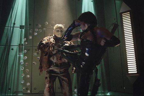 (far right) Lisa Ryder battles Kane Hodder as Jason Voorhees in New Line Cinema's, JASON X.