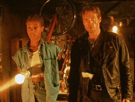 Jada Pinkett Smith and William Sadler in Tales from the Crypt: Demon Knight (1995)