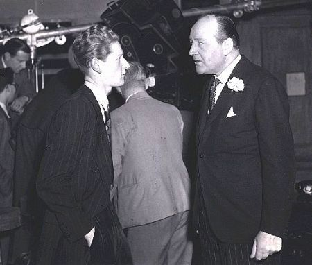 Fred R. Krug and Cecil Parker on the set of