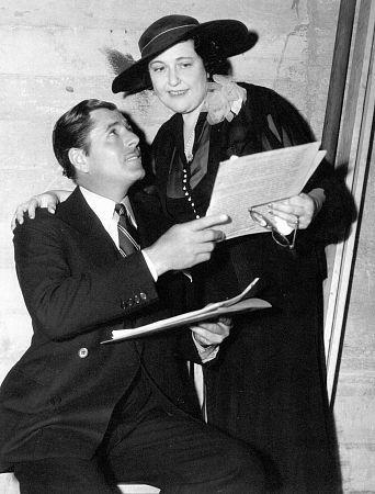 Gossip Columnist Louella Parsons with Warner Baxter, c 1935.