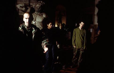 From left: Christopher Eccleston, Naomie Harris, and Cillian Murphy