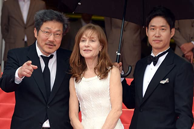 Isabelle Huppert, Sang-soo Hong, and Joon-sang Yoo at an event for Da-reun na-ra-e-seo (2012)