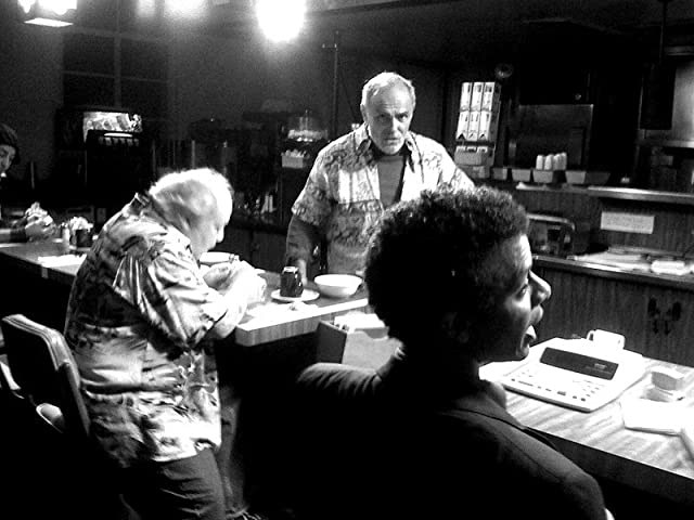 Paul (John Saxon) and Mel (Larry Gelman) get some information from Joe (Phil LaMarr) in