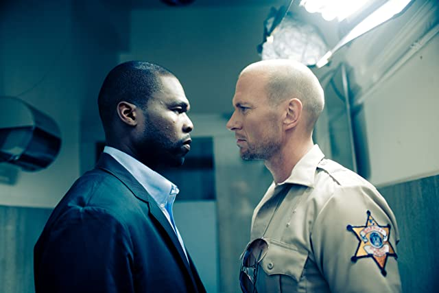 Luke Goss and 50 Cent in Blood Out (2011)