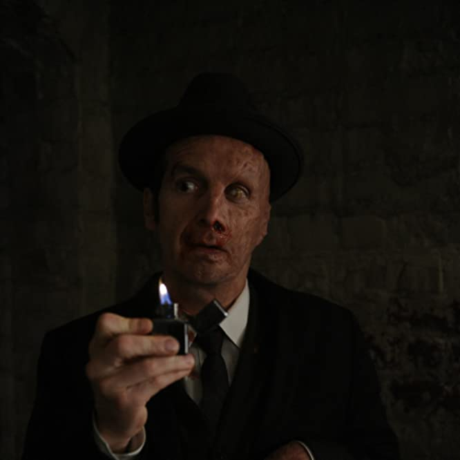 Denis O'Hare in American Horror Story (2011)
