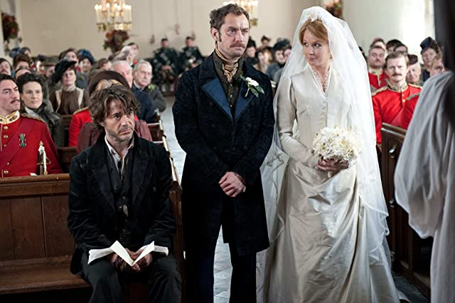 Jude Law, Robert Downey Jr., and Kelly Reilly in Sherlock Holmes: A Game of Shadows (2011)