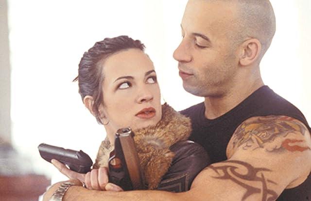 Asia Argento and Vin Diesel in xXx (2002)